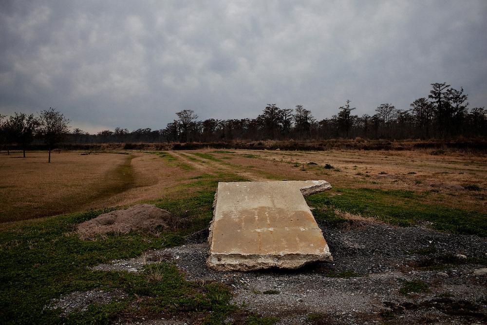 A slab of concrete in a field at Daneco Alligator Farm in Houma, Louisiana on Friday, February 19, 2010.
