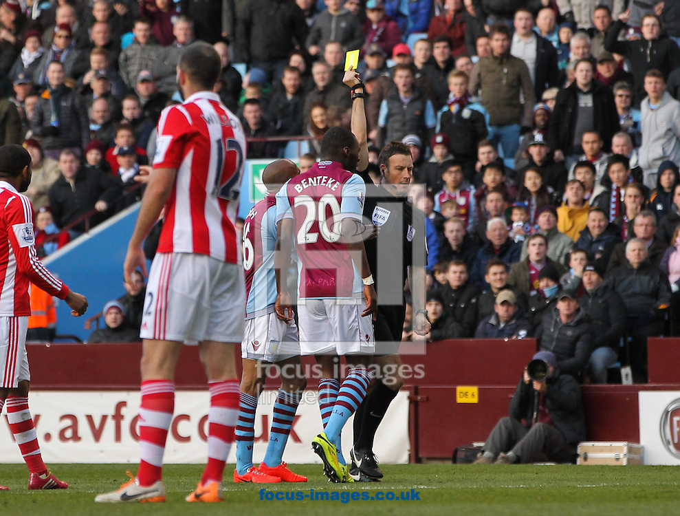 Christian Benteke (centre) of Aston Villa is shown a yellow card during the Barclays Premier League match at Villa Park, Birmingham<br /> Picture by Tom Smith/Focus Images Ltd 07545141164<br /> 23/03/2014