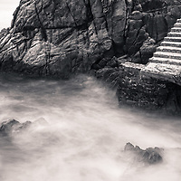 A stairway lifts from the turbulent sea. Puerto Escondido, Oaxaca, Mexico.