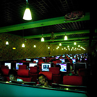BEIJING, AUG.6, 2009 : young people play games in an internet bar in Beijing..Since summer 2009 social network pages like Twitter and Facebook have been banned in China  and China's government censors have taken new measures in December that limit its citizens' ability to set up personal Web sites and to view hundreds of Web sites offering films, video games and other forms of entertainment.