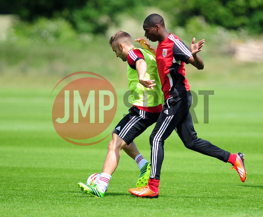 Bristol City's Jordan Wynter adds pressure to Liam Kelly - Photo mandatory by-line: Dougie Allward/JMP - Tel: Mobile: 07966 386802 28/06/2013 - SPORT - FOOTBALL - Bristol -  Bristol City - Pre Season Training - Npower League One