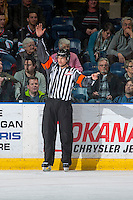 KELOWNA, CANADA - MARCH 1: Referee Tyler Adair makes a call on the ice at the Kelowna Rockets against the Prince George Cougars on MARCH 1, 2017 at Prospera Place in Kelowna, British Columbia, Canada.  (Photo by Marissa Baecker/Shoot the Breeze)  *** Local Caption ***