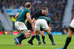 New Zealand Lock Brodie Retallick is tackled by South Africa Hooker Bismarck du Plessis - Mandatory byline: Rogan Thomson/JMP - 07966 386802 - 24/10/2015 - RUGBY UNION - Twickenham Stadium - London, England - South Africa v Wales - Rugby World Cup 2015 Semi Finals.