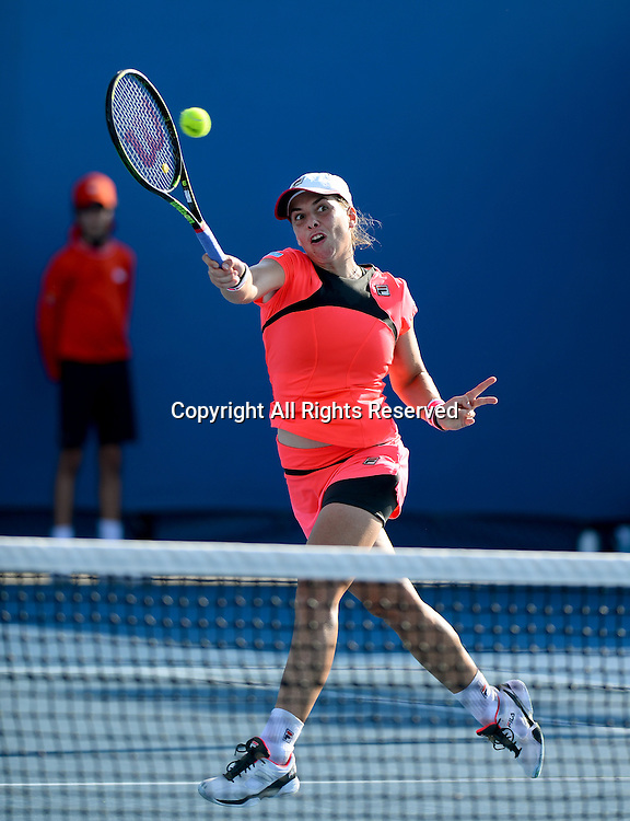 Marina Erakovic (NZ) plays 1st round doubles with partner Monica Puig (PUR)<br /> 2015 Australian Open Tennis / Day 3<br /> Grand Slam of Asia Pacific<br /> Melbourne Park, Vic Australia<br /> Wednesday 21 January 2015<br /> &copy; Sport the library / Jeff Crow