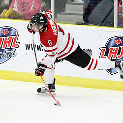 COBOURG, - Dec 19, 2015 -  Gold Metal Game - Russia vs Canada West at the 2015 World Junior A Challenge at the Cobourg Community Centre, ON. Brinson Pasichnuk #6 of Team Canada West shoots the puck during the first period.(Photo: Tim Bates / OJHL Images)