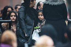 © Licensed to London News Pictures . 16/01/2017 . Oldham , UK .  Mourners wait outside the church for the funeral of cousins Helina Kotlarova and Zaneta Krokova at St Paul's Church in Oldham . The two girls , aged 12 and 11 respectively , were killed by a hit and run driver whilst crossing the road together , on New Years Eve (31st December 2016) . Photo credit: Joel Goodman/LNP