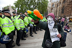 © Licensed to London News Pictures. 01/06/2013. London, UK. Supporters of Unite Against Fascism (UAF) are seen marching in central London today after they broke through a police cordon to confront British National Party (BNP) supporters who were demonstrating in central London today (01/06/2013). The BNP protest was held in response to the killing of Drummer Lee Rigby, who died after an attack in Woolwich where religious extremism may have been the motive. Photo credit: Matt Cetti-Roberts/LNP