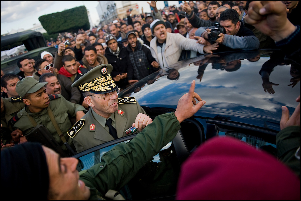 "General Rachid Ammar, the chief of staff of the Tunisian army, addresses the 'Caravan of Freedom' on Government Square. Protesters of the 'Caravan of Freedom' continue their sit-in on the Kasbah square in Tunis, Tunisia on January 24, 2011. Protesters said they will continue their sit-in until the fall of the interim Government and satisfaction of their demands for decent life. Copyright Benjamin Girette /// On january the 14th 2011, Zine el-Abidine Ben Ali President of Tunisia and his famous wife Leila Trabelsi as know as ""The regent of Carthage"" are forced by thousands of protesters to escape the country after 24 years of power. As a result a new democraty is in design for the next six months until Tunisians organize national democratic elections, it might be the birth of the first democraty in the arab world.."