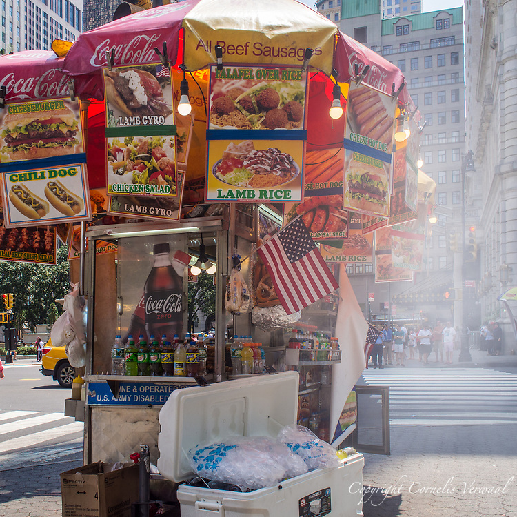 Some serious cooking going on in the foodcart with smoke billowing out the side; 59th street at the Plaza Hotel.