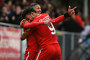 Jobi McAnuff of Leyton Orient (7) is hugged by Macauley Bonne of Leyton Orient (9) after scoring his second goal to make the score 0-3 during the Vanarama National League match between Harrogate Town and Leyton Orient at Wetherby Road, Harrogate, United Kingdom on 22 September 2018.