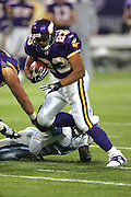 MINNEAPOLIS - NOVEMBER 21:  Running back Michael Bennett #23 of the Minnesota Vikings gains some rushing yards in the open field against the Detroit Lions at the Hubert H. Humphrey Metrodome on November 21, 2004 in Minneapolis, Minnesota. The Vikings defeated the Lions 22-19. ©Paul Anthony Spinelli  *** Local Caption *** Michael Bennett