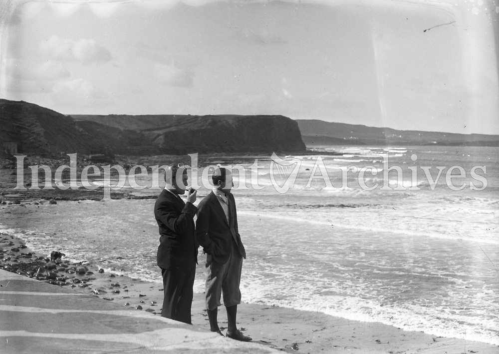 Transatlantic Flights in Clare, Pilots Pond and Sabelli pictured on a beach, 17 May 1934.<br /> Capt George R Pond (with pipe) and Lieut Cesare Sabelli.<br /> Their plane was called 'Leonardo Da Vinci', Serial Number NR13137. <br /> (Part of the Independent Newspapers Ireland/NLI Collection)