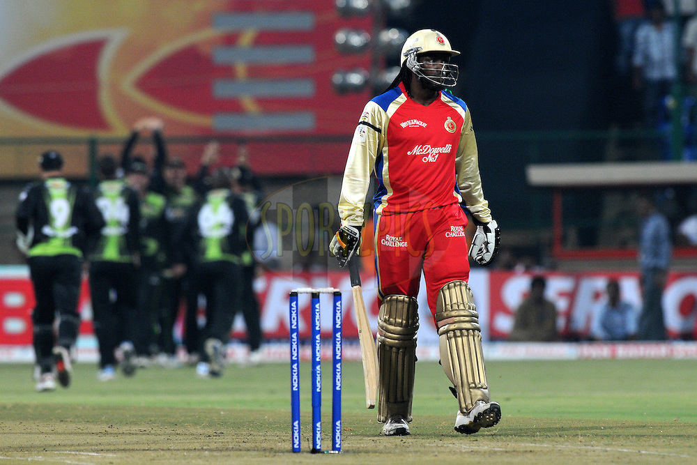 Chris Gayle of Royal Challengers Bangalore walks back after getting out during match 1 of the NOKIA Champions League T20 ( CLT20 )between the Royal Challengers Bangalore and the Warriors held at the  M.Chinnaswamy Stadium in Bangalore , Karnataka, India on the 23rd September 2011..Photo by Pal Pillai/BCCI/SPORTZPICS