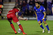 AFC Wimbledon striker Andy Barcham (17) takes on Rochdale midfielder Matthew Lund (8) during the EFL Sky Bet League 1 match between AFC Wimbledon and Rochdale at the Cherry Red Records Stadium, Kingston, England on 28 March 2017. Photo by Matthew Redman.