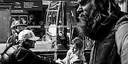 Street photography, Queen Street, Auckland, New Zealand. Bearded man walking by woman and child, Asian observer, and bus driver.
