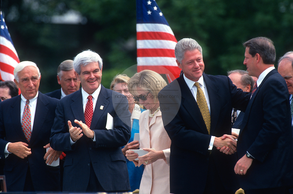 WASHINGTON, DC, USA - 1997/08/05: U.S. President Bill Clinton shake hands with Vice President Al Gore after signing the balanced budget bill into law in a ceremony on the South Lawn of the White House August 5, 1997 in Washington, DC. Senator Frank Lautenberg, Speaker Newt Gingrich and First Lady Hillary Clinton look on.  (Photo by Richard Ellis)