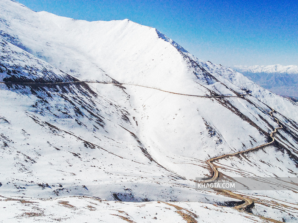 Morning landscape of the road to Khardung-La in Ladakh covered in snow. Famous for being the world's highest motorable pass at 18,600ft. <br />