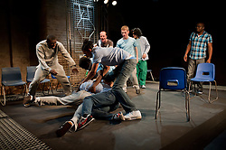 "© Copyright licensed to London News Pictures. 12/11/2010. ""Inside"" by Philip Osment, presented by Playing Out at the Roundhouse, Camden, London. Based on the real experiences of young fathers in prison, the play deals with big questions surrounding relationships, both with their own fathers and with their children. In this scene, a fiht breaks out. The cast: Jim Pope, Andre Skeete, Ayo Bodunrin, Kyle Thorne, Michael Amaning, Darren Douglas, Segun Olaiya, Jacob James Beswick, Tarkan Cetinkaya."