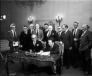 29/03/1976<br /> 03/29/1976<br /> 29 March 1976<br /> Petroleum exploration licences signed at Iveagh House, Dublin. Minister for Industry and Commerce, Mr Justin Keating T.D. and senior oil company executives representing the firms to which licences were being granted signed petroleum exploration licences in respect of exploration offshore of Ireland. Image shows The Minister (seated right) signing the licence with Mr. P. Guillaumat, Chairman , Elf Aquitaine, representing the Elf Aquitaine Group, including Net and ERGAS.