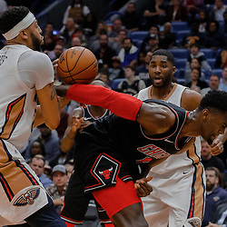 Jan 22, 2018; New Orleans, LA, USA; New Orleans Pelicans forward Anthony Davis (23) steals the ball from Chicago Bulls center Cristiano Felicio (6) during the fouth quarter at  the Smoothie King Center. The Pelicans defeated the Bulls 132-128 in double overtime. Mandatory Credit: Derick E. Hingle-USA TODAY Sports