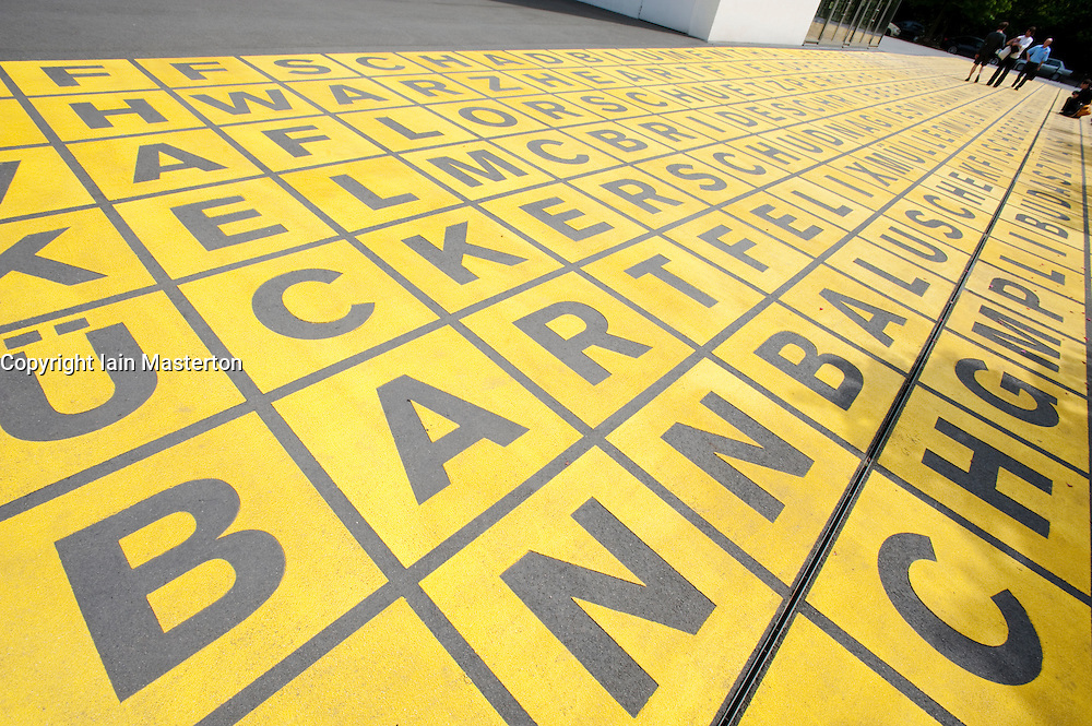 Large written characters on ground at entrance to Berlinische Galerie modern art museum in Mitte Berlin Germany