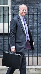 © Licensed to London News Pictures. 25/10/2016. London, UK. Transport Secretary Chris Grayling leaves Downing Street after the government sub-committee on airports, which is expected to green light the construction of a third runway at Heathrow airport. Photo credit: Rob Pinney/LNP