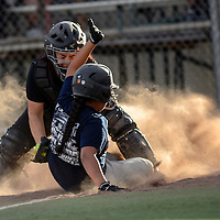 060314  Adron Gardner/Independent<br /> <br /> Yankee Alyssa Manuelito slides safe as Oriole Gabby Olivar attempts the tag over home plate at Ford Canyon Park in Gallup Tuesday.
