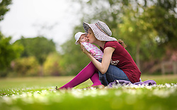 © Licensed to London News Pictures. 18/06/2015. Leeds, UK. A women & her baby enjoy the warm weather in Temple Newsam park this afternoon in Leeds. Photo credit : Andrew McCaren/LNP