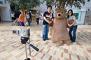 Jeju Island. Jungmun Tourist Complex. Teddybear Museum. Toursists taking souvenir photos with bears.