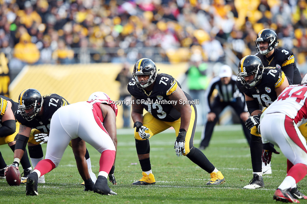 Pittsburgh Steelers guard Ramon Foster (73) gets set to block during the 2015 NFL week 6 regular season football game against the Arizona Cardinals on Sunday, Oct. 18, 2015 in Pittsburgh. The Steelers won the game 25-13. (©Paul Anthony Spinelli)