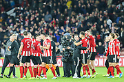 Sheffield United players celebrate after their victory over Arsenal in the Premier League match between Sheffield United and Arsenal at Bramall Lane, Sheffield, England on 21 October 2019.