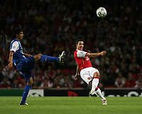 Photo: Chris Ratcliffe.<br /> Arsenal v FC Porto. UEFA Champions League, Group G. 26/09/2006.<br /> Robin Van Persie of Arsenal clears from Lucho Gonzalez of Porto.