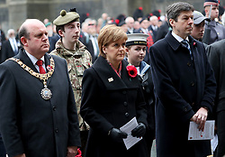 (Left to right) Edinburgh Lord Provost Frank Ross, First Minister Nicola Sturgeon and presiding officer of the Scottish Parliament Ken Macintosh during a two minute silence at the Stone of Remembrance at the City Chambers, Edinburgh, on the 100th anniversary of the signing of the Armistice which marked the end of the First World War.