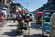 Milk churns on rickshaw at Khari Baoli food market, Old Delhi, India