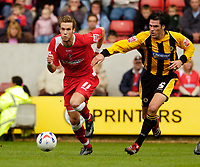 Photo: Leigh Quinnell.<br /> Swindon Town v Boston United. Coca Cola League 2. 30/09/2006. Swindons Andy Monkhouse gets away from Bostons Mark Greaves.