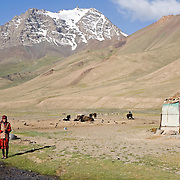 Kyrgyz woman and yurt, Pshart Valley, Tajikistan
