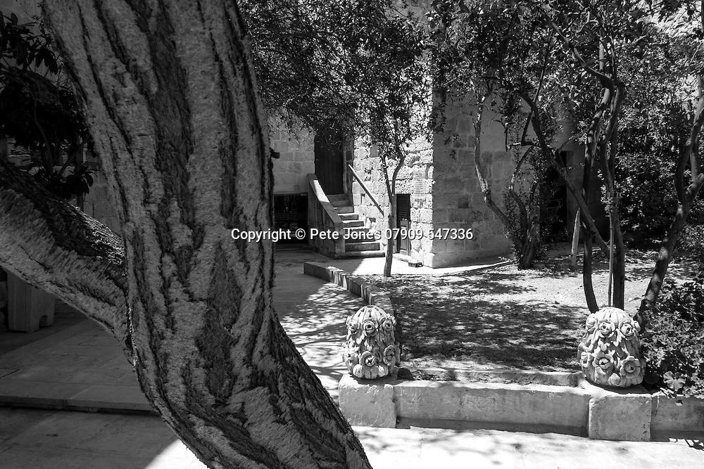 Courtyard to cafe in Mdina Rabat,<br /> Malta, Europe.<br /> Summer 2016.