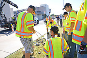 Workers at Tugo Bike Share's Rio Nuevo Station installation.