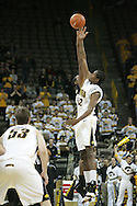 26 NOVEMBER 2007: Iowa forward/center Kurt Looby (52) gets the tip off at the start of Wake Forest's 56-47 win over Iowa at Carver-Hawkeye Arena in Iowa City, Iowa on November 26, 2007.