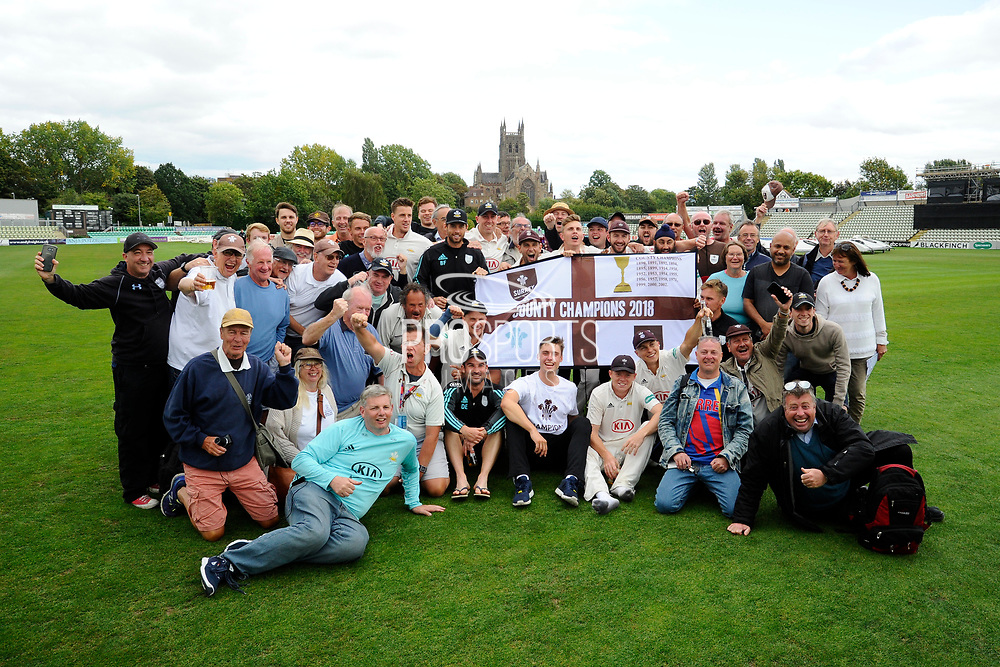 Surrey are Champions - The Surrey players celebrate winning the County Championship with fans on the field with the Cathedral behind them during the final day of the Specsavers County Champ Div 1 match between Worcestershire County Cricket Club and Surrey County Cricket Club at New Road, Worcester, United Kingdom on 13 September 2018.
