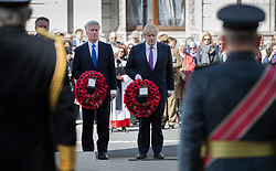 © Licensed to London News Pictures. 25/04/2017. London, UK. Defence Sectretary Michael Fallon stands  Foreign Secretary Boris Johnson during the ANZAC Day ceremony at the Cenotaph in Whitehall. A dawn ceremony and service was held at The Australian War Memorial and The New Zealand War Memorial at Hyde Park Corner.  April 25th is the day that Australia and New Zealand remember the dead of all wars. Photo credit: Peter Macdiarmid/LNP