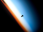 Feb 09, 2010 - International Space Station, USA - In a very unique setting over Earth's colorful horizon, the silhouette of the space shuttle Endeavour is featured in this photo by an Expedition 22 crew member on board the International Space Station, as the shuttle approached for its docking on Feb. 9 during the STS-130 mission. <br /> ©ZP/Exclusivepix