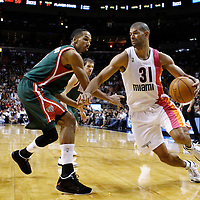22 January 2012: Miami Heat small forward Shane Battier (31) drives past Milwaukee Bucks point guard Shaun Livingston (9) during the Milwaukee Bucks 91-82 victory over the Miami Heat at the AmericanAirlines Arena, Miami, Florida, USA.
