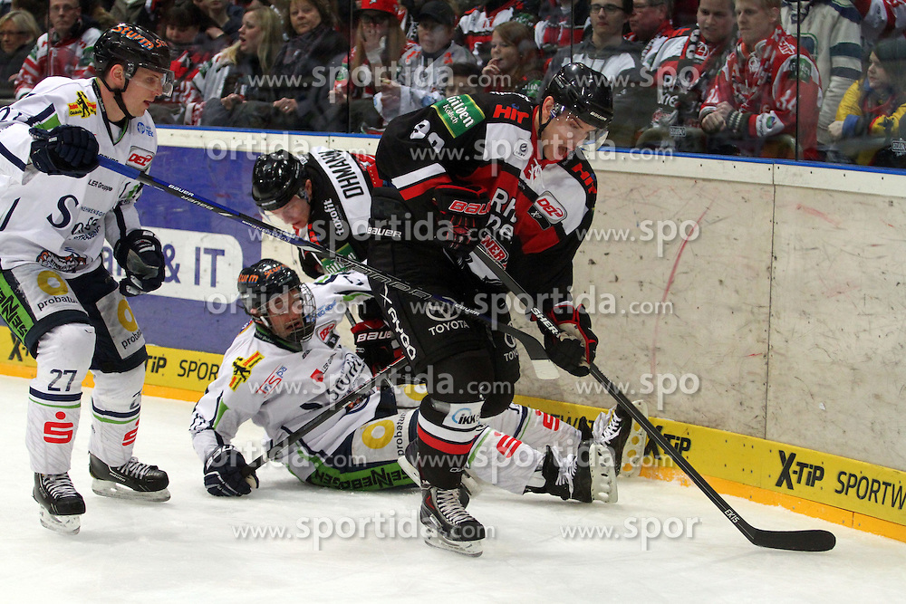27.02.2015, Lanxess Arena, K&ouml;ln, GER, DEL, K&ouml;lner Haie vs Straubing Tigers, 51. Runde, im Bild Mxime Sauve (Koeln) kommt vor Sandro Schoenberger (Straubing) an den Puck // during Germans DEL Icehockey League 51st round match between K&ouml;lner Haie and Straubing Tigers at the Lanxess Arena in K&ouml;ln, Germany on 2015/02/27. EXPA Pictures &copy; 2015, PhotoCredit: EXPA/ Eibner-Pressefoto/ Weiss<br /> <br /> *****ATTENTION - OUT of GER*****