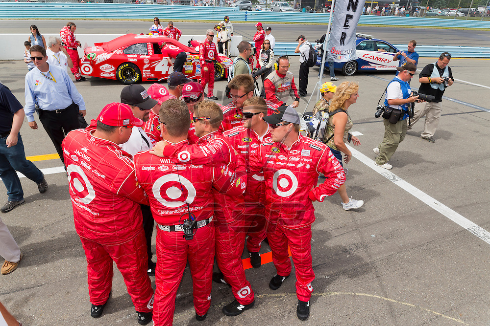 WATKINS GLEN, NY - AUG 12, 2012:  The Target crew prepare for the Finger Lakes 355 at The Glen in Watkins Glen International, NY.