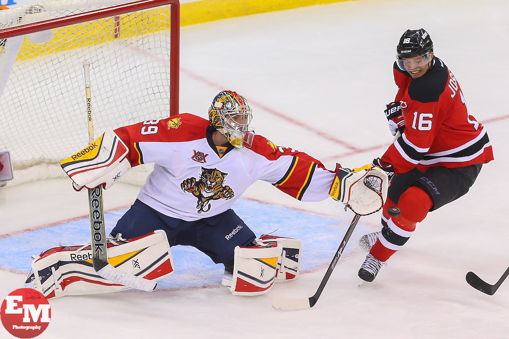 Mar 31, 2014; Newark, NJ, USA; Florida Panthers goalie Dan Ellis (39) makes a glove save in front of New Jersey Devils center Jacob Josefson (16) during the third period at Prudential Center. The Devils defeated the Panthers 6-3.