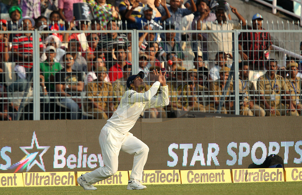 Pragyan Ojha of India takes the catch to dismiss Tino Best of West Indies  during day three of the first Star Sports test match between India and The West Indies held at The Eden Gardens Stadium in Kolkata, India on the 8th November 2013<br /> <br /> Photo by: Ron Gaunt - BCCI - SPORTZPICS