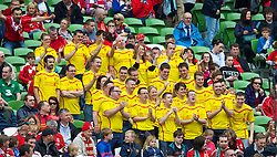 DUBLIN, REPUBLIC OF IRELAND - Wednesday, May 14, 2014: A select few Liverpool supporters wear the new yellow Warrior away shirt during a postseason friendly match against Shamrock Rovers at Lansdowne Road. (Pic by David Rawcliffe/Propaganda)