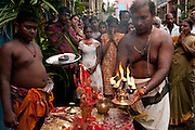 The Hindu deity Bhairava is blessed and bathed on his return to his Kovil after a journey around the streets of Colombo 13. Festival at small Hindu temple off Jampettah Street.
