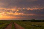 After riding out this severe thunderstorm outside of Faith, South Dakota, the conditions came together for a spectacular sunset. I stopped on this two-track road in the middle of a prairie, trying not to get stuck in the mud. Gorgeous colors filled the sky in every direction, with occasional flashes of lightning.